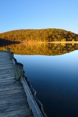 Fototapete - Dock at Mountain Lake in Autumn