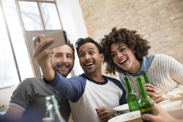 Happy friends taking a selfie