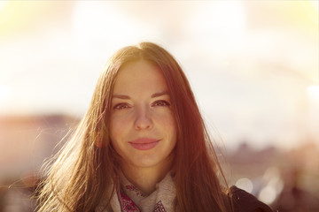 Portrait of smiling young woman at backlight