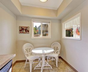 Extra dinning area with white chairs and table.