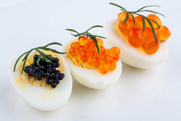 Salmon, trout and sturgeon caviar served on quail eggs