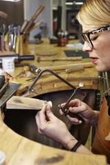 Goldsmith in workshop at work