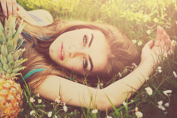 Gorgeous young woman lying in grass