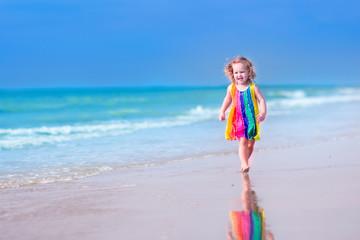 Little girl running on a beach