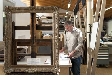 Frame-maker in his workshop