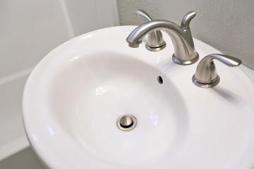 White sink in bathroom.