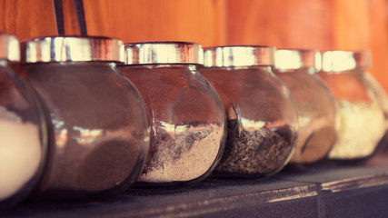 herbs and spices in glass jars, bbq area