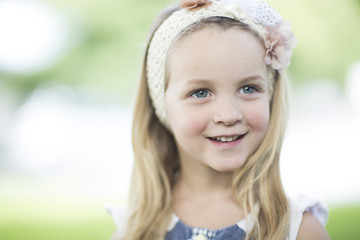 Portrait of smiling little girl with hair-band