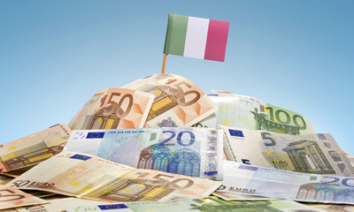 Flag of Italy sticking in a pile of various european banknotes.(