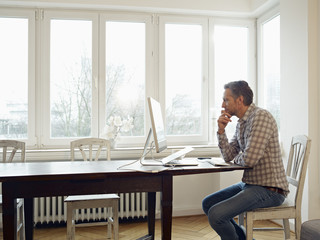 Germany, Cologne, Mature man working from home