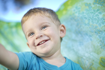 Portrait of smiling little boy outdoors