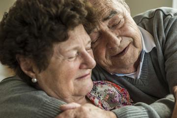 Happy senior couple head to head