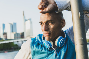 Sportive man with headphones outdoors