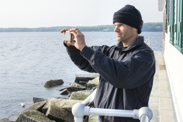 Man takes scenic cell phone photo in Maine harbor