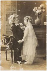 Vintage photo of cute children in wedding dress