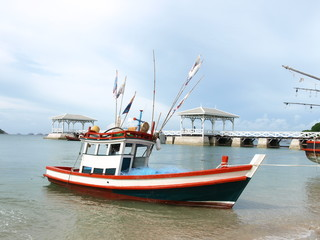 fishing boat and wood waterfront pavilion, at Koh si chang island in Thailand