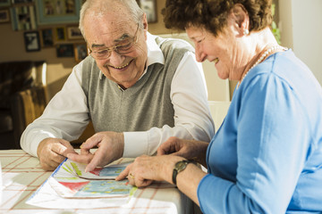 Happy senior couple watching child's drawing