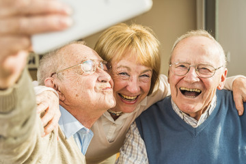 Cheerful seniors taking selfie