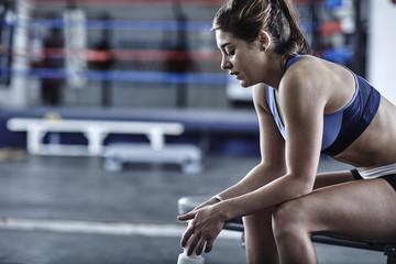 Athlete in gym having a break