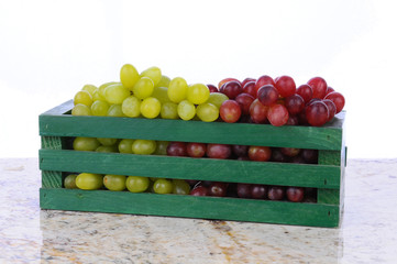 Red and Green Grapes in Wood Crate