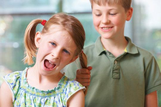 Boy Bullying Girl By Pulling Hair