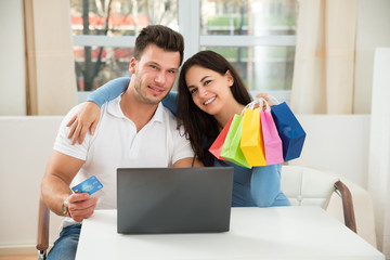 Happy Couple Shopping Online On Laptop