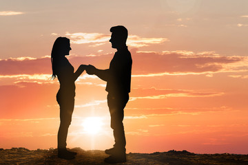 Silhouette Of Young Couple At Sunset