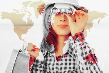 Beautiful tourist girl looking through binoculars
