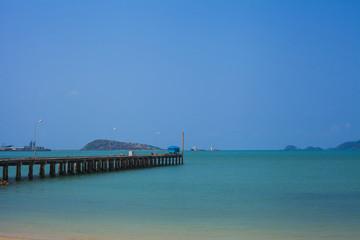 The bridge extends into the sea