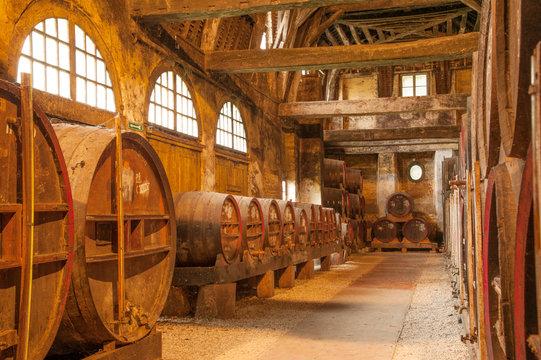 Row of oak barrels in Calvados distillery,  Normandy