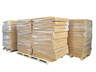 Stock Photo - Stacks of cardboard boxes on wooden pallets isolat