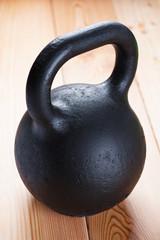 Large black cast iron weight