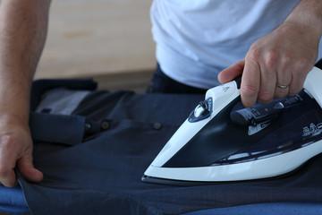 Modern man doing the ironing
