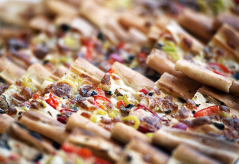 Pides, the Turkish pastry with vegetables on a wooden cutting board