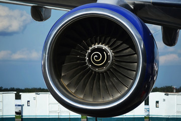 Turbine of airplane closeup under the wing, Boeing color