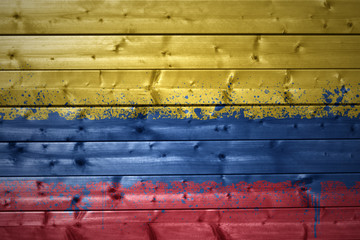 painted colombian flag on a wooden texture