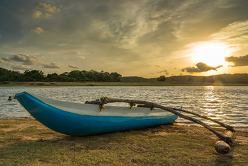Catamaran at Giritale Lake by Sunset