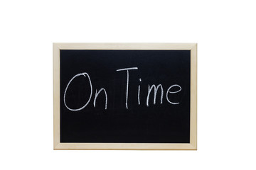 On Time written with white chalk on blackboard.