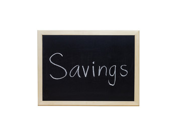 Savings written with white chalk on blackboard.