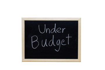 Under Budget written with white chalk on blackboard.