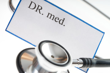 stethoscope / Nameplate of a doctor with stethoscope