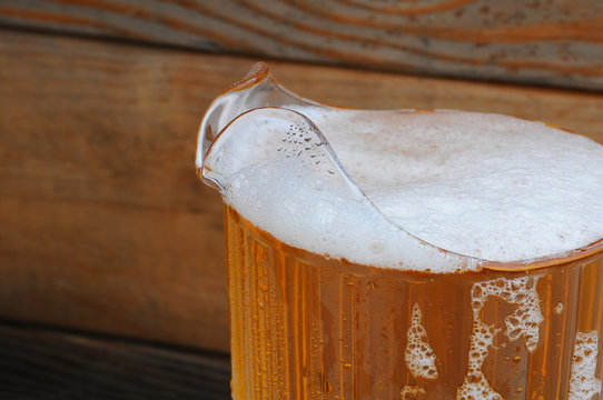 Closeup of Beer Pitcher with Wood Background