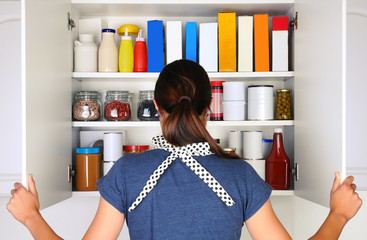Woman Opening Full Pantry