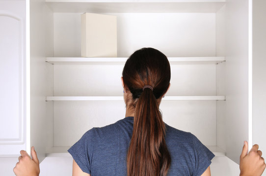 Woman Looking in Empty Pantry