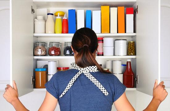 Woman Opening Full Pantry
