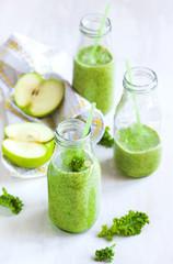 Green juice in bottle. Healthy drink.