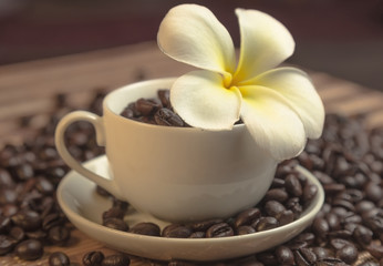 flower in a cup of coffee