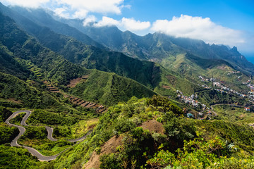 Green mountains valley with road