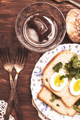 Breakfast, boiled egg,  chocolate cheese,  bread with greens
