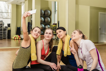 Group of girls in fitness class making selfi